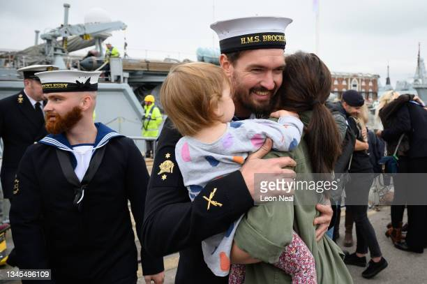 Family members greet Navy personnel after they disembark from HMS Brocklesby on October 08, 2021 in Portsmouth, England. For the first time in 22...