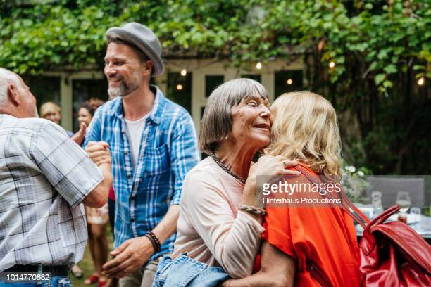family members greeting one another before bbq meal - 50 54 jahre stock-fotos und bilder