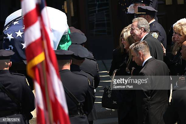 Family members grieve as the casket for fallen New York City police officer Brian Moore is brought into a Long Island church on May 8 2015 in Seaford...