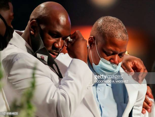 Family members grieve as they speak during the funeral for George Floyd on June 9 at The Fountain of Praise church in Houston George Floyd will be...