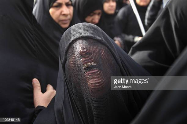Family members grieve during the funeral procession of antigovernment protester Abdul Ridha Mohammed on February 22 2011 in Malkiya Bahrain Abdul...