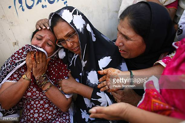 Family members grieve outside the Edhi Morgue October 19 2007 in Karachi Pakistan A suicide bombing killed at least 136 people in an assassination...