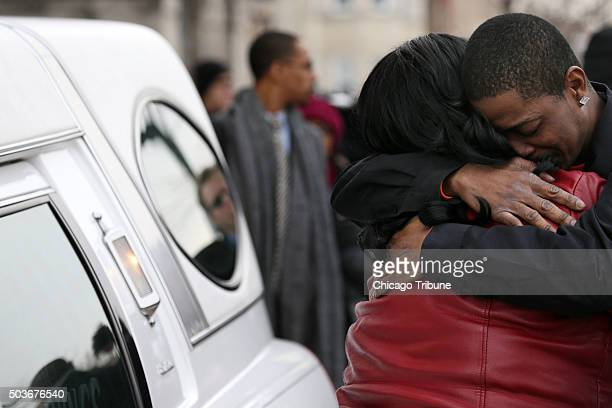 Family members grieve over a hearse following the funeral for Bettie Jones Wednesday Jan 6 at New Mount Pilgrim Missionary Baptist Church in Chicago...