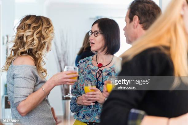 family members having a drink at family reunion. - mimosa stock pictures, royalty-free photos & images