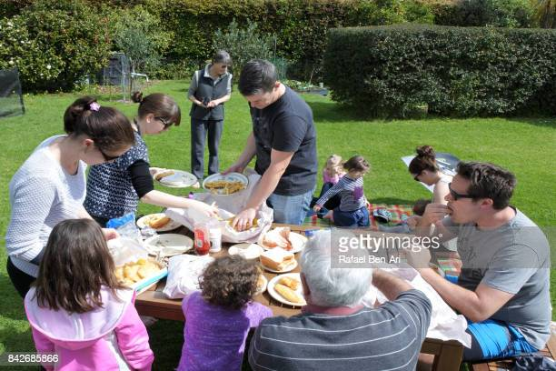 Family members having a picnic together outdoor