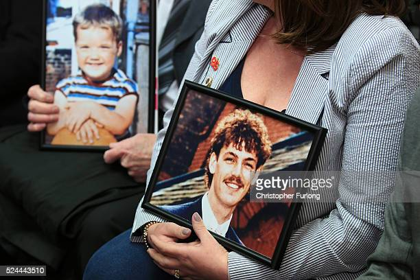 Family members hold photographs of loved ones who died in the Hillsborough disaster during a Hillsborough Justice Campaign Press Conference on April...