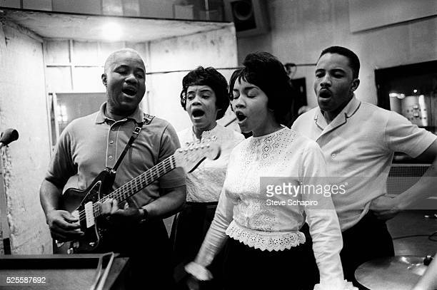 Family members in band The Staple Singers in a recording studio