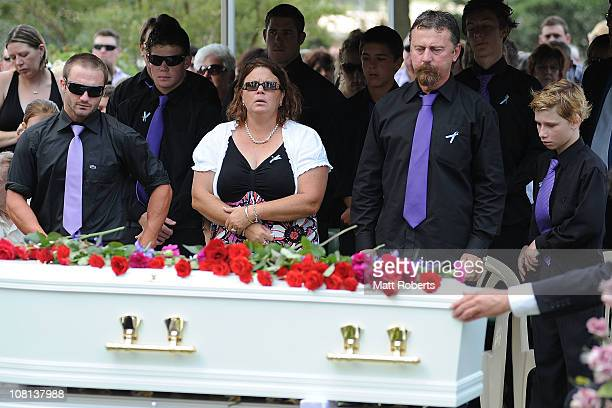 Family members including father John Tyson and son Blake Tyson mourn at the funeral of mother Donna Maree Rice and son Jordan Rice killed in last...