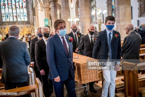 Family members including John Hume Jr , carry the casket as the funeral takes place of former SDLP leader and Nobel Peace Prize winner John Hume at...