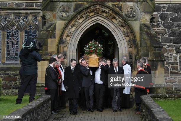 Family members including son Jon Gregg carry the remains of former Manchester United and Northern Ireland footballer Harry Gregg as his funeral takes...
