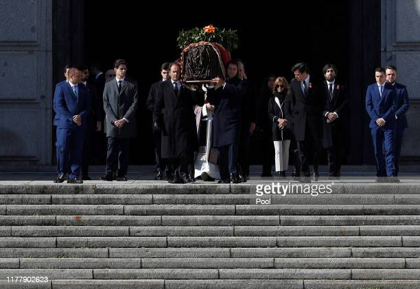 Family members Jose Cristobal and Luis Alfonso de Borbón carry the coffin of Francisco Franco out of the basilica of the Valley of the Fallen...