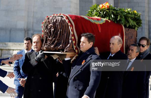Family members Jose Cristobal Luis Alfonso de Borbón Francis Franco and Jaime MartínezBordiú carry the coffin of Francisco Franco out of the basilica...