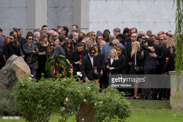 Family members lay flowers graveside at funeral services for Soundgarden frontman Chris Cornell at Hollywood Forever Cemetery on May 26 2017 in...