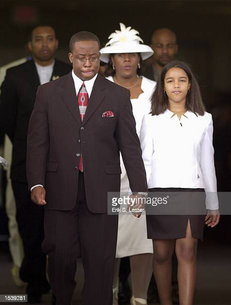 Family members leave the church after the funeral of TLC singer Lisa Left Eye Lopes at the New Birth Missionary Baptist Church May 2 2002 in Lithonia...