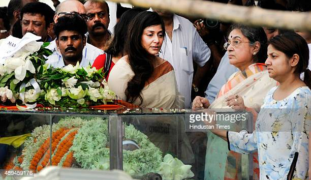 Family members look on as salute by gunfire being given to the mortal remains of late BCCI President Jagmohan Dalmiya at Eden Garden Cricket ground...