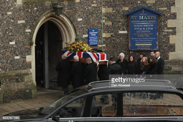 Family members look on as the coffin of former England Football Team Manager Graham Taylor arrives ahead of his funeral at St Mary's Church on...