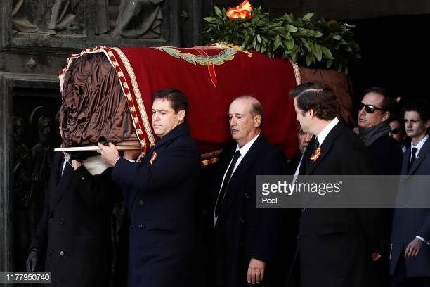 Family members Luis Alfonso de Borbón and Francis Franco carry the coffin of Francisco Franco out of the basilica of the Valley of the Fallen...