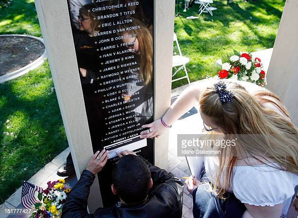 Family members make pencil rubbings of the names of loved ones after the Idaho Fallen Soldier memorial service at the Idaho Fallen Soldier Memorial...