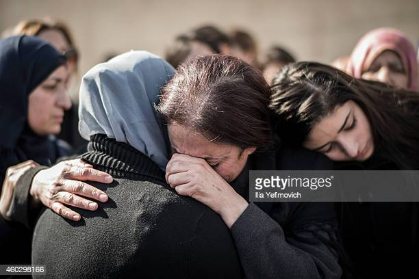Family members mourn and cry during a funeral of Minister Ziad Abu Ein on December 11, 2014 in Ramallah, West Bank. The Palestinian Minister died...
