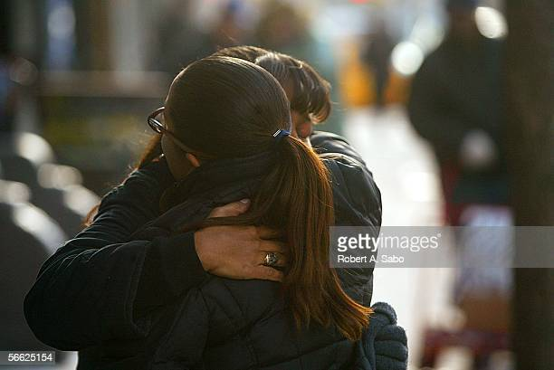 Family members mourn and embrace outside the Ortiz Funeral Home January 16 2006 in New York City The Nixzmary Brown child abuse case is another in a...