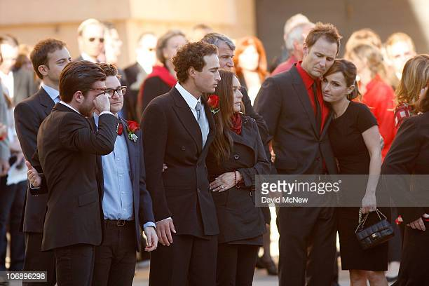 Family members mourn as the casket containing the body of Italian film mogul and Hollywood producer Dino De Laurentiis is brought out of the...