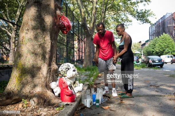 Family members mourn at the memorial for Davell Gardner Jr., a 1-year-old who was killed while sitting in a stroller at a barbecue in 2020, amid a...