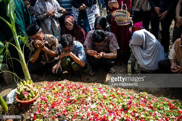 Family members mourn next to the grave of Jannatun Cintya Dewi who was a passenger on the illfated Lion Air flight JT 610 which crashed on October 29...