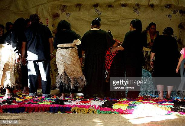Family members mourn over the body of slain bystander Halatau Naitoko after he was returned to his family at his home on January 25 2009 in Auckland...