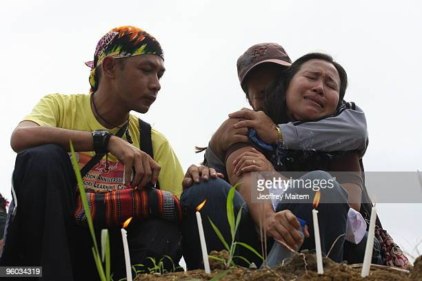 Family members mourn relatives who were among the 57 people killed in a massacre on November 23 2009 at the site of massacre on January 23 2010 in...