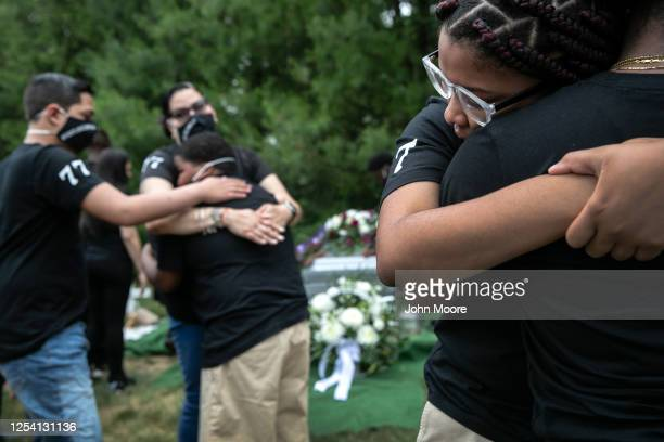 Family members mourn the death of Conrad Coleman Jr at his burial on July 03 2020 in Rye New York Coleman died of Covid19 on June 20 just over two...