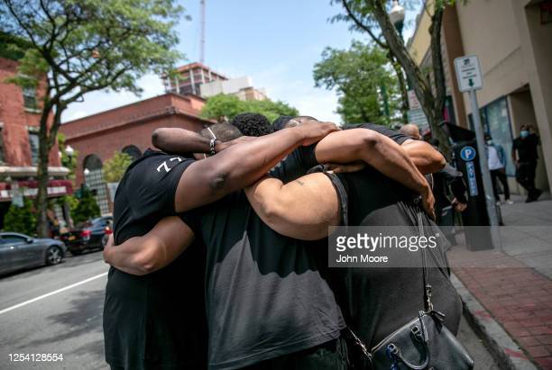 Family members mourn the death of Conrad Coleman Jr following his funeral service on July 03 2020 in New Rochelle New York Coleman died of COVID19 on...