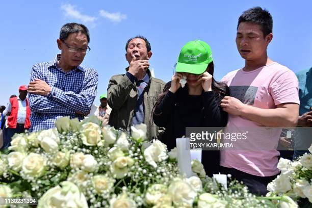 TOPSHOT Family members mourn the victims at the crash site of the Ethiopian Airlines operated Boeing 737 MAX aircraft at Hama Quntushele village in...