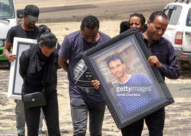 Family members of 28yearold Captain Yared Getecho visit the crash site of Ethiopian Airlines Flight ET302 on March 14 2019 in Ejere Ethiopia All 157...