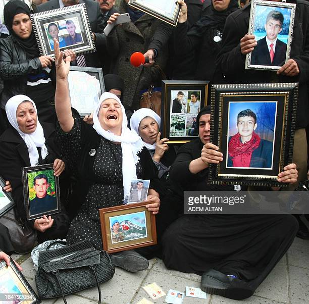 Family members of 34 Turkish Kurdish civilians, who were killed in December 2011 in Uludere at the Turkey-Iraq border by Turkish military jets that...