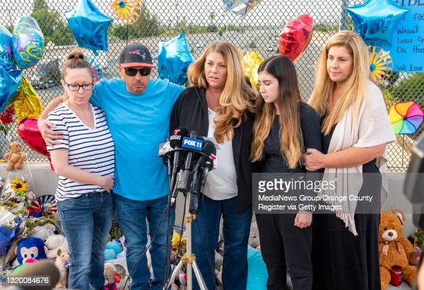 Family members of 6-year-old Aiden Leos stand at a makeshift memorial on the Walnut Avenue overpass at the 55-freeway in Orange on Tuesday, May 25,...