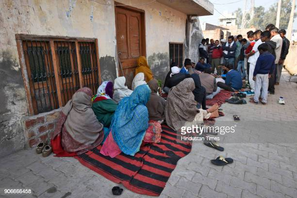 Family members of a Class 12 student mourn after the naked body of the boy who is believed to be a minor was found in a canal near Kirmach village of...