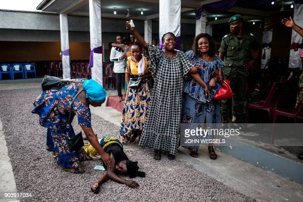 TOPSHOT Family members of a person killed in protests on December 31 2017 react as their relatives' coffin arrives from the morgue on January 11 in...