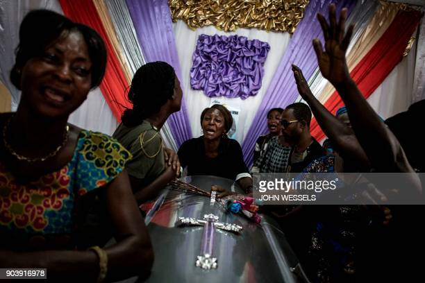 TOPSHOT Family members of a person killed in protests on December 31 2017 react over their relatives' coffin after it arrived from the morgue on...