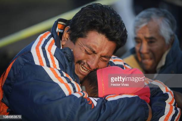 Family members of a victim cry when recognizing the body after an explosion in a pipeline belonging to Mexican oil company PEMEX on January 19 2019...