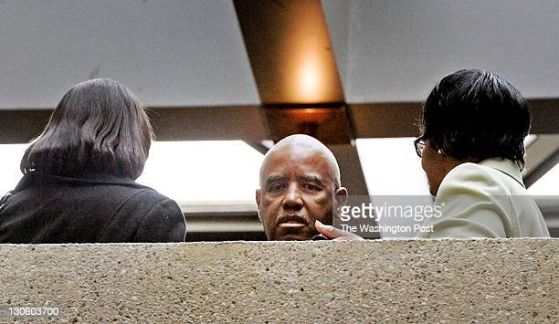 Family members of accused murderer Brittany Norwood talk outside the courtroom as jury selection begins in her trial on October 2011 in Rockville MD...