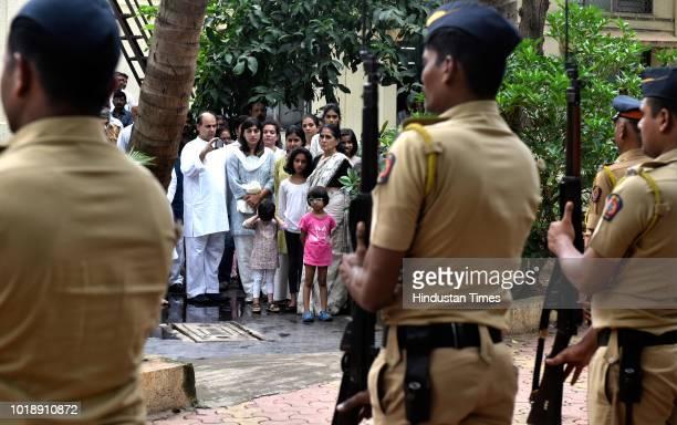 Family members of Ajit Wadekar watch the Gaurd of Honor during the funeral of Ajit Wadekar at Shivaji Park on August 17 2018 in Mumbai India Former...