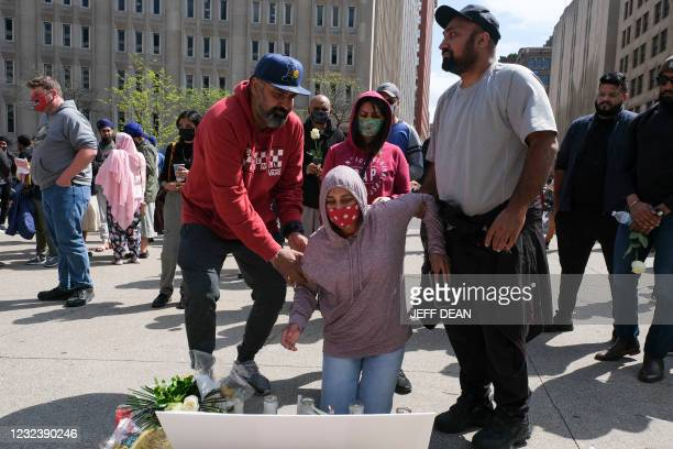 Family members of Amarjeet Johal, who was killed in a mass shooting, attend a vigil in Indianapolis, Indiana on April 18, 2021 to remember the...