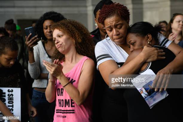Family members of Antwon Rose II embrace as they listen to speakers during a protest calling for justice for the 17yearold on June 26 2018 in...