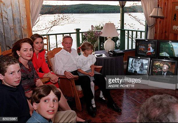 Family members of Canadian Prime Minister Jean Chretien are gathered at the Prime Minister's home of Shawanigan, Quebec, 02 June, to follow Canadian...