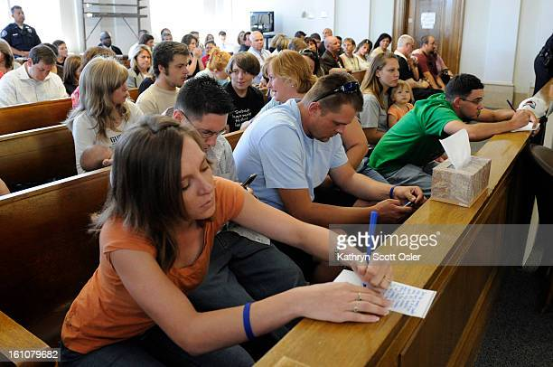 Family members of Chandler Grafner, including his aunt, Stefanie Evilsizer, left, are given pen and paper to write down comments that they want to...
