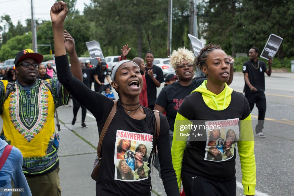 Family members of Charleena Lyles, including her sister, Monika Williams (R), lead a march through north Seattle on June 20, 2017 in Seattle, Washington. Officers from the Seattle Police Department shot and killed Lyles, a pregnant mother of four, on June 18.