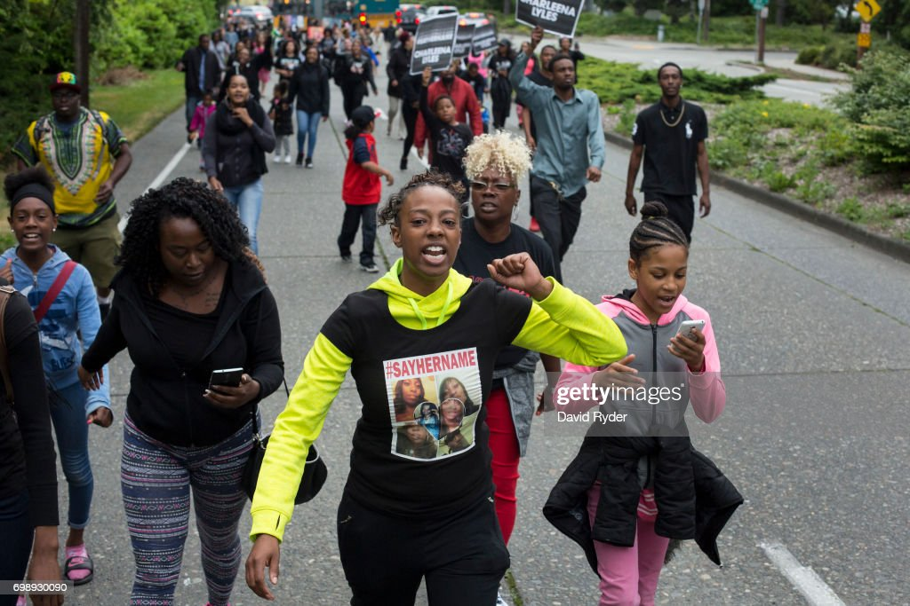 Family members of Charleena Lyles, including her sister, Monika Williams (C), lead a march through north Seattle on June 20, 2017 in Seattle, Washington. Officers from the Seattle Police Department shot and killed Lyles, a pregnant mother of four, on June 18.