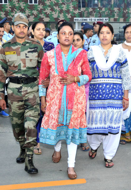 Family members of CPL Nilesh Kumar at Air Force Station on October 12 2017 in Chandigarh India