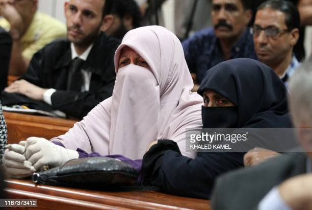 Family members of Egyptian Muslim Brotherhood members attend a verdict and sentencing session of a retrial for them on charges of espionage with the...