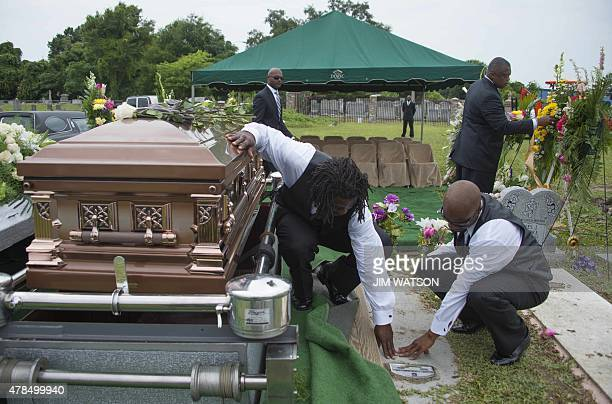 Family members of Emanuel AME Church shooting victim Ethel Lance pay their respects to Terrie Washington Ethel Lanc's daughter who died of cancer at...